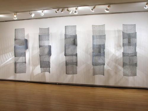 "<div class='artwork-listing'><span class='artwork-listing-artist'><a href=""/users/yvette-kaiser-smith"" class=""active"">Yvette Kaiser Smith</a></span>, <span class='artwork-listing-title'><a href=""/portfolio/12117/etudes-pi-5-squared"">Etudes from Pi in 5 Squared </a></span>, <span class='artwork-listing-year'>2011</span>, <span class='artwork-listing-materials'>Crocheted fiberglass with polyester resin.</span>, <span class='artwork-listing-dimensions'>72"" x 191"" x 33""</span></div>"