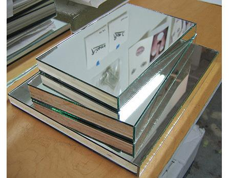 "<div class='artwork-listing'><span class='artwork-listing-artist'><a href=""/user/0""></a></span>, <span class='artwork-listing-title'><a href=""/portfolio/4024/coffe-table-books"">Coffe Table Books</a></span>, <span class='artwork-listing-year'>2006</span>, <span class='artwork-listing-materials'>Plywood, Mirror</span>, <span class='artwork-listing-dimensions'>Dimensions Variable</span></div>"