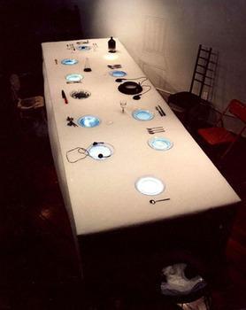"<div class='artwork-listing'><span class='artwork-listing-artist'><a href=""/users/adriana-varella"">Adriana Varella</a></span>, <span class='artwork-listing-title'><a href=""/portfolio/5853/anthropophagous-banquet"">ANTHROPOPHAGOUS BANQUET</a></span>, <span class='artwork-listing-year'>1994</span>, <span class='artwork-listing-materials'>Materials 9 monitors 20', 9 VCRs, wood, acrilon, transparent dishes, tableware, cups, chairs, etc.</span></div>"